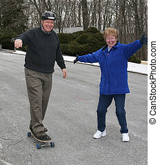 Senior skateboarding - Woman Senior Citizen showing...