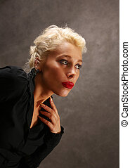 In style of a retro - Portrait of the beautiful blonde in In...