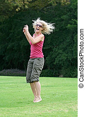 Laughing and jumping, healthy woman enjoying herself -...