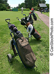 Golf B d Palos_0008. - Several golf bags on a golf course.