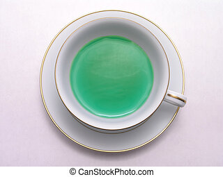 Green Herbal tea 2 - Green Herbal tea in a tea cup on saucer