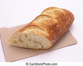French Baguette on brown napkin