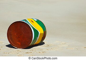 Beach pollution - An old rusty and empty paint bucket on the...