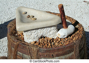 old nut cracker made with stone and wood