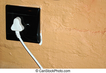 Plug it in - A white South African plug on a tuscan painted...