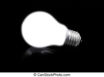 close-up of lit light bulb on black