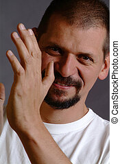 man clapps his hands - a man with beard and a white t -...