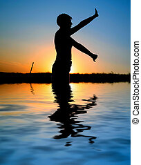 sunset silhouette doing excercises, PERSON ISN\\\'T...