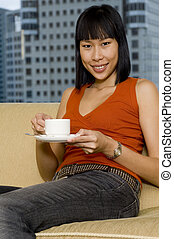 Woman Having Tea - A beautiful chinese woman drinking tea...