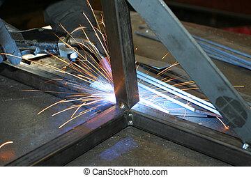 welder at work3 - welder working on metal frame with sparks