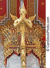 Praying Statue - Decorative praying statue on a Chinese...