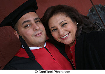 University graduate with his mother - happy and successful