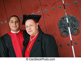 University graduate in robes with his grandmother - Degree...