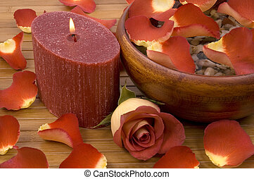 Spa Scene - Rose petals and candle in a spa