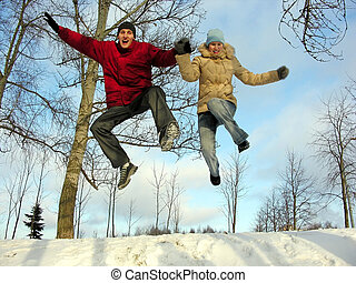 jumping couple winter