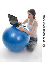 Exercise Ball Desk 1 - Young woman in casual clothes sitting...