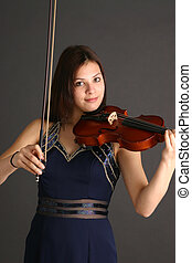 Girl with Violin - Girl wearing formal dress and playing...
