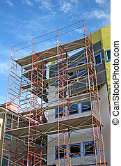 Scaffolding on front of condo construction site