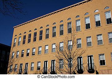 Stucco Condos - Stucco condominium building on a city street