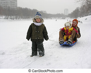 mother with children sled winter