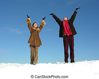 couple with hands up. winter