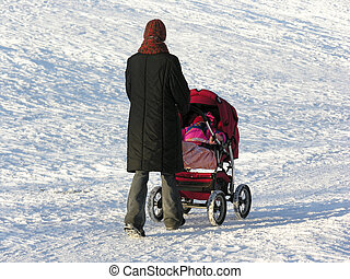 mother with baby carriage winter