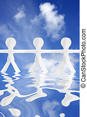 Teamwork - White paper people with blue sky and water...