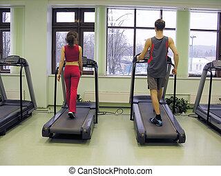 health club - behind girl and boy in health club