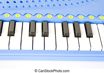 Child\\\'s piano - blue child\\\'s piano isolated on white