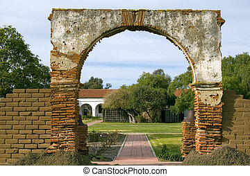 The old Arch - Entrance to the courtyard of San Luis Rey...