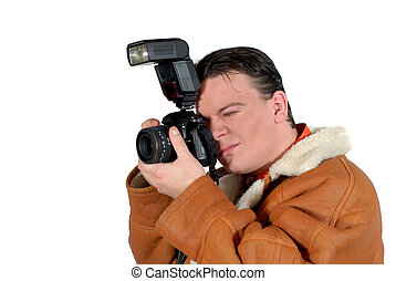 Young successful Press photographer, paparazzi with camera...