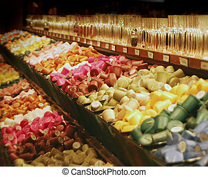 Candle Euphoria - bins of brightly colored votive candles...