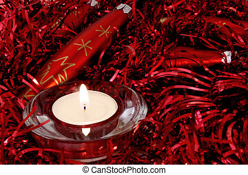 Red Christmas ornaments and candle