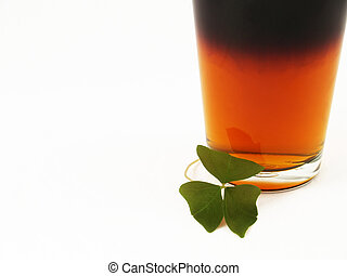 St Patricks Day Beer and Shamrock - Black and tan beer in a...