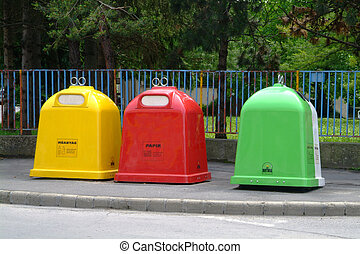 trash - three trash bins in yellow red and green