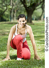 On Your Marks - A young woman crouched ready to run