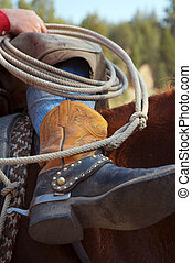 Cowboy\\\'s Boots - boots and ropes of a cowboy on his horse