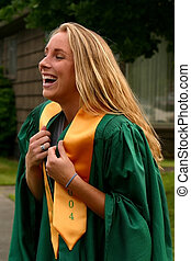 Graduation Day - young blond girl happy to be graduating