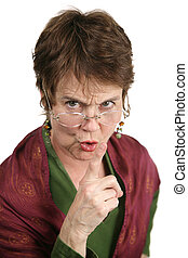 Hush - An angry middle aged librarian putting her finger to...