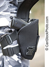 gun holster with a 9mm weapon inside