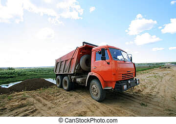 red dumper - Red dumper on a under construction road