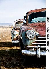 vintage cars vertical version - vintage car - two vintage...