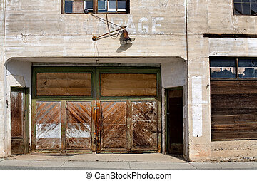 old abandoned garage - facade of an old and long abandoned...