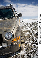 offroading aftermath - SUV in need of a wash after straying...