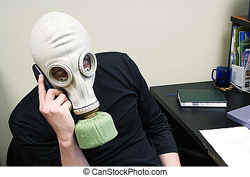 speaks by phone - The person in a gas mask speaks by phone