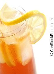 Lemon iced tea - Glass of cold lemon iced tea with ice,...
