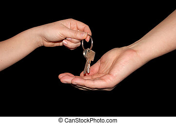 Handing over the keys, isolated on black with clipping-path...