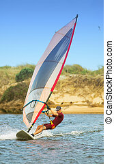 windsurfer 01 - Fast moving windsurfer on the water at...