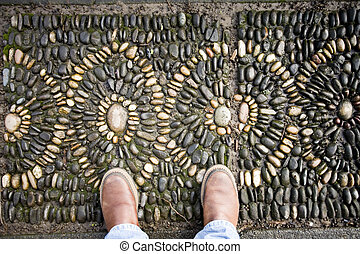 Stone Mosaic with Two Feet - Photo of an abstract stone...