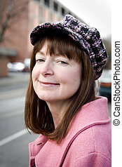 Woman in Pink Wool Coat and Jaunty Hat - Photo of an...